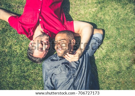 Homosexual couple at a romantic date outdoors - Gay couple in love flirting and having fun #706727173