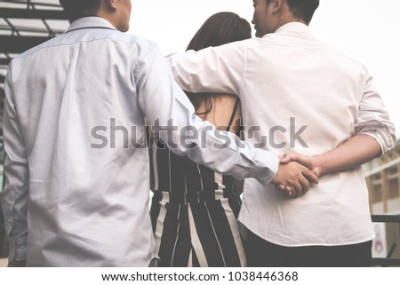homosexual man hug woman while holding hands with secret lover. gay couple in love triangle. boyfriend cheating on girlfriend. same sex and homosexuality concept