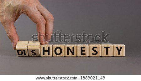 Honesty or dishonesty symbol. Businessman hand turns cubes and changes the word 'dishonesty' to 'honesty'. Beautiful grey background. Business and honesty or dishonesty concept. Copy space. Photo stock ©