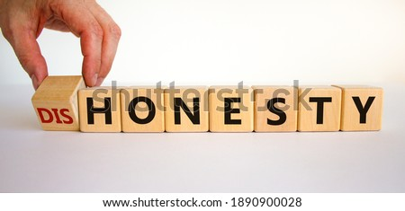 Honesty or dishonesty symbol. Businessman hand turns cubes and changes the word 'dishonesty' to 'honesty'. Beautiful white background. Business and honesty or dishonesty concept. Copy space. Photo stock ©
