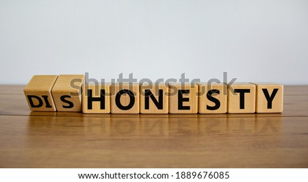 Honesty or dishonesty symbol. Turned cube and changed the word 'dishonesty' to 'honesty'. Beautiful wooden table, white background. Business and honesty or dishonesty concept. Copy space. Photo stock ©