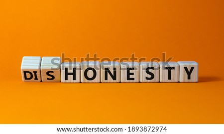 Honesty or dishonesty symbol. Turned cube and changed the word 'dishonesty' to 'honesty'. Beautiful orange background. Business and honesty or dishonesty concept. Copy space. Photo stock ©