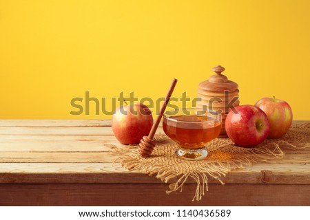 Honey and apples on wooden table. Jewish holiday Rosh Hashanah background