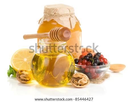 honey and fruit isolated on white background