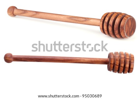 Honey dipper from wood on white Background
