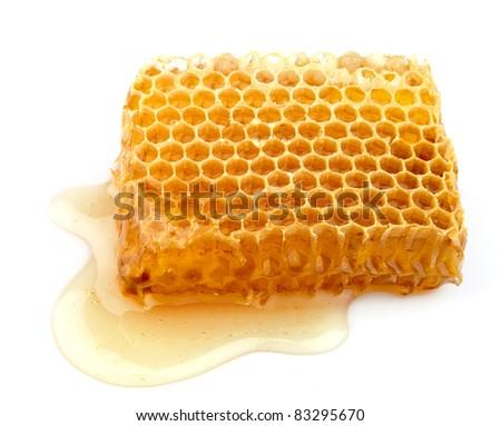 Honey honeycombs on the white background