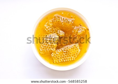 Honey in a white plate. Honey with honeycombs