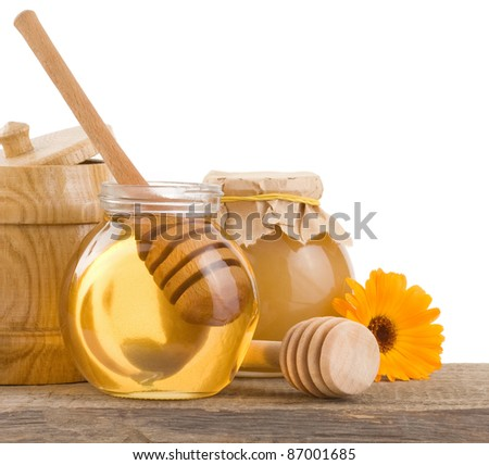 honey in glass and wood pot isolated on white background - stock photo