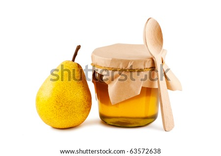 Honey in glass jar, pear, wooden spoon isolated on white background.