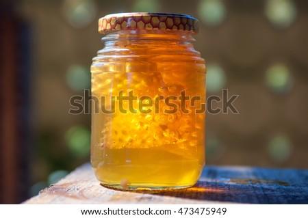 Honey in glass pot