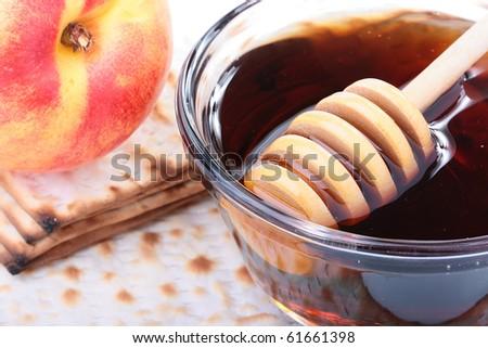 Honey in glasswares with wooden honey dipper.