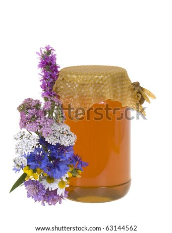 honey in jar and flowers on white background