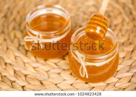 honey in two jars - Shutterstock ID 1024823428