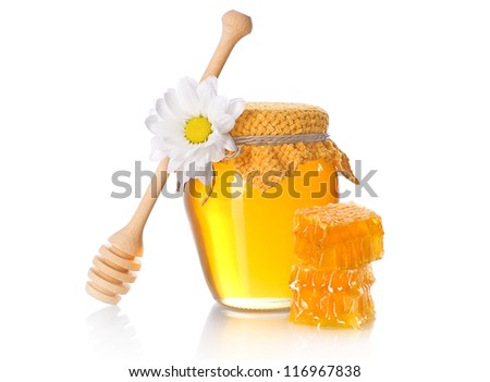 Honey jar with honey dipper and a stack of honeycomb slice on white background