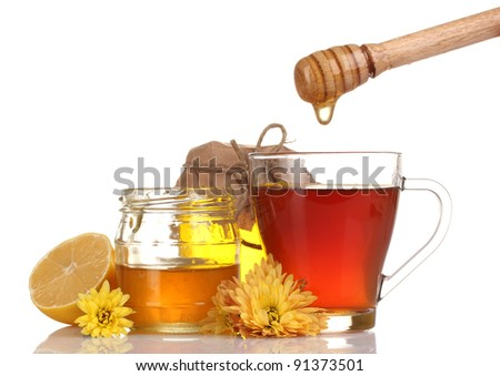 honey, lemon and a cup of tea isolated on white