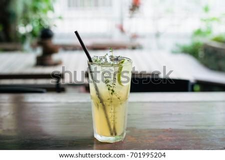 Honey lemon drink on the cafe table background