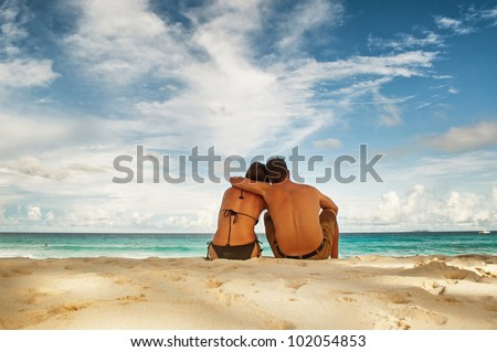 Honey moon couple on beautiful tropical vacation in the warm sunny Seychelles island oceans and palm trees