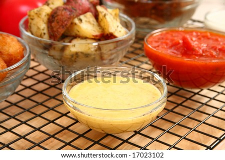 Honey mustard in bowl in kitchen or restaurant.
