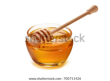 Photo of  Honey pot and dipper isolated on white background as package design element
