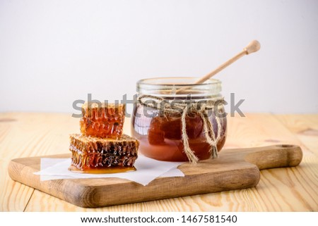 honey with dipper on wooden background, honey comb and honey stick #1467581540