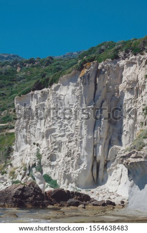 Honeycomb weathering. Detail of characteristic cliff at Sa Rocca Lada, Sardinia island, Italy #1554638483