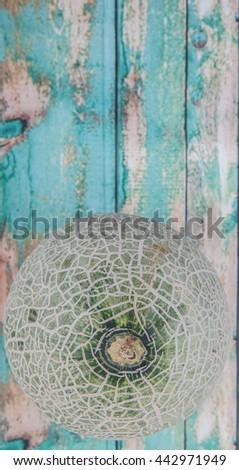 Honeydew fruits over wooden background #442971949