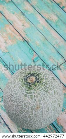Honeydew fruits over wooden background #442972477