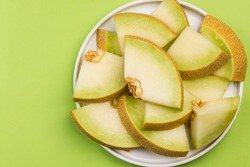 Honeydew Musk Melon Slices on Plate on Pastel Background, Serving Portion.
