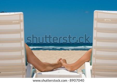 Honeymoon Couple in beach chairs on resort