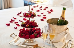 Honeymoon suite with chocolate strawberries and an opened bottle of champagne