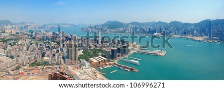 Hong Kong aerial view panorama with urban skyscrapers boat and sea.