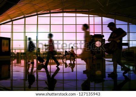 Hong Kong airport, travelers walking