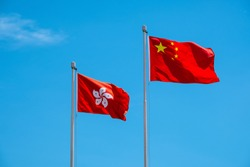 Hong Kong And Chinese Flag With Blue Sky