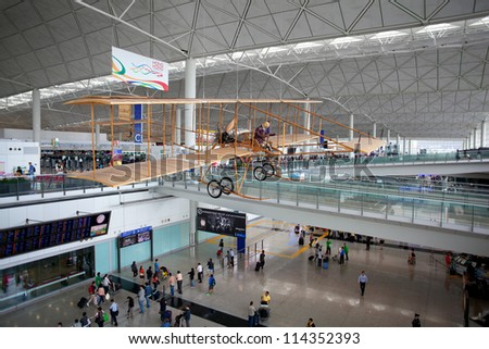 HONG KONG - APRIL 18: A replica of Farman aircraft hangs in International Airport on April 18, 2012, in Hong Kong. The original Farman aircraft made the first flight in Hong Kong, on March 18, 1911.