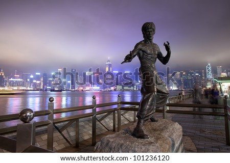 HONG KONG - APRIL 16: Bruce Lee`s monument in the night at the Avenue of stars, on April 16, 2012, in Hong Kong. Bruce Lee was  the most influential and famous  martial artist of the 20th century
