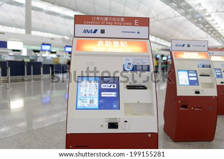 HONG KONG - APRIL 01: check-in kiosks in Airport on April 01, 2014 in Hong Kong, China. Hong Kong International Airport is one of the best airport in the annual passenger survey by Skytrax.