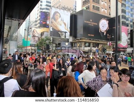 HONG KONG - APRIL 3: People queuing outside a clothing store on April 3, 2012 in Hong Kong. In Hong Kong, for companies, there is a 17.5% corporate tax, which is lower than international standards.