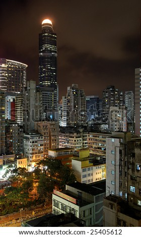 Hong Kong by night: different styles of buildings in Mong Kok district, from very modern skyscraper to low-rise.