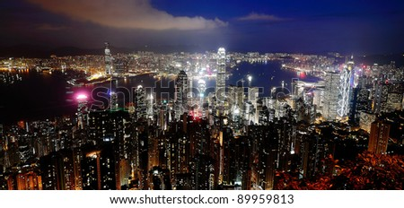 Hong Kong Central District Victoria Harbour skyline at night aerial panorama