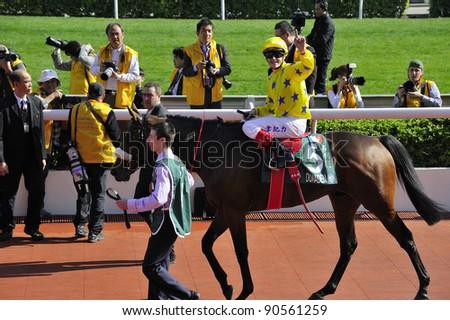 HONG KONG, CHINA - DEC. 11: C Williams wins the Cathay Pacific Hong Kong Vase during the International Horse Race on Dec. 11, 2011 in Hong Kong, China.