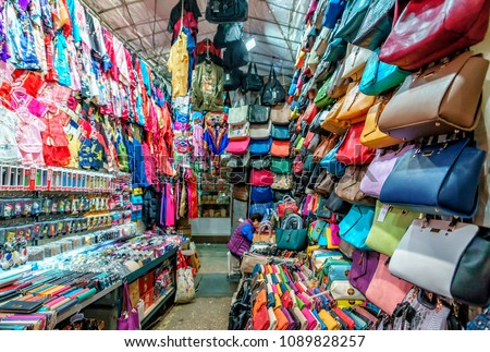 Hong Kong, China - January 19, 2016: Night view of Hong Kong street retail Lady's Market in Mong Kok. View of a haberdashery store selling various colorful fancy women's stuff #1089828257