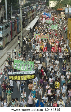 HONG KONG, CHINA - JULY 1: People going to protest for the government policy in Hong Kong on the anniversary of Handover Day on July 1, 2011 in Hong Kong, China.