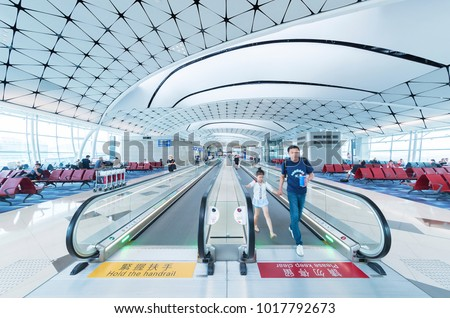 Hong Kong, China -  May 30,2017 : Escalator in departure Hall in Hong Kong International Airport. Hong Kong International Airport handles more than 70 million passengers per year. stock photo