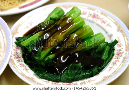 Hong Kong  Chinese Food table. Hong Kong cuisine is mainly influenced by Cantonese cuisine, European cuisines (especially British cuisine) and non-Cantonese Chinese cuisines.