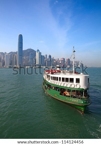 "HONG KONG - DECEMBER 3: Ferry ""Solar star"" leaving Kowloon pier on December 3, 2010 in Hong Kong, China. Hong Kong ferry is in operation in Victoria harbor for more than 120 years."