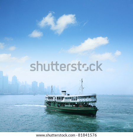 """HONG KONG - DECEMBER 14: Ferry """"Solar star"""" leaving Kowloon pier on December 14, 2008 in Hong Kong, China. Ferry is in operation for over 120 years and is one main tourist attractions of the city. - stock photo"""