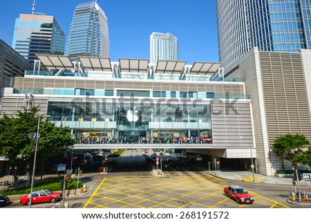 Hong Kong - February 13, 2015: Apple Retail Stores. Shoppers trying out Apple products and shopping. Located in International Finance Centre, Central, Hong Kong.