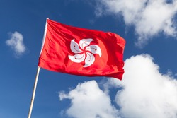 Hong Kong flag waving over blue cloudy sky background
