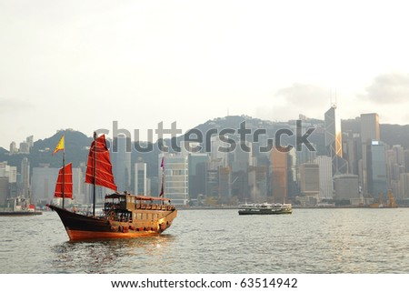 Hong Kong harbor with red sail boat