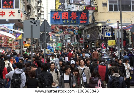 HONG KONG -JAN 29: Shoppers and visitors crowd a street on Jan 29, 2011 in Hong Kong, China. Hong Kongs population was about 7.07 million in 2011, with an average annual growth rate of 0.6%.